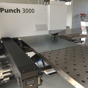 CNC TruPunch 3000 punching thru metal sheet